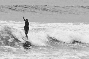 longboarder surfing